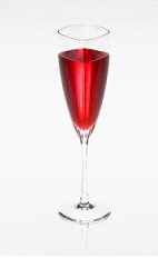 The Almond Stardust is a red colored drink made from Disaronno amaretto liqueur, vodka, strawberry liqueur and prosecco, and served in a chilled champagne flute.