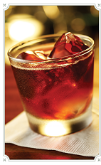The Kentucky Swap drink is made from Chambord raspberry liqueur, Southern Comfort liqueur, bourbon, white cranberry juice, gingerbread syrup and ginger ale, and served in a rocks glass over ice.