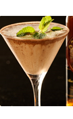 There's always room for ice cream, especially in your glass. The Too Full Flor Dessert cocktail recipe is made form Flor de Cana rum, Licor 43, chocolate ice cream, vanilla syrup and mint, and served in a chilled cocktail glass.