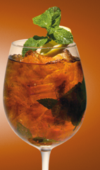 The Xantea cocktail recipe is made from Xante cognac, Earl Grey tea, mint and lemon, and served over ice in a stemmed glass.