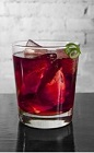 The Amazoni drink recipe is a dark red colored cocktail made from Cedilla acai liqueur, gin and Campari, and served over ice in a rocks glass.