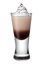 The Java Jingle is a brown colored shot made from espresso, Smirnoff whipped vodka, Bailey's Irish cream and whipped cream, and served in a chilled shot glass.