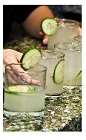 The Khira drink recipe is made from Okanagan gin, lime juice, cardamom syrup, ginger beer and cucumber, and served over ice in a rocks glass garnished with a cucumber slice.
