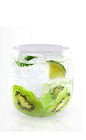 The Kiwi Lime is a clear colored drink made from Yeyo tequila, simple syrup, kiwi and lime, and served over ice in a rocks glass.