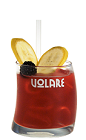 The Mexican Monkey is a fun red drink recipe made from Volare Banana liqueur, tequila, sweet and sour mix and blackberries, and served over ice in a rocks glass garnished with banana slices and blackberry.