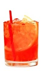 The Nina is an orange drink made from Patron tequila, sweet vermouth, aperol and grapefruit soda, and served over ice in a rocks glass.