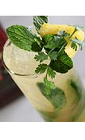 The Tribal Cana is an exotic cocktail recipe made from Flor de Cana rum, lime juice, pineapple juice, vanilla extract, simple syrup, cilantro and mint, and served over ice in a Collins glass.
