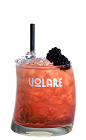 The Volare Bramble is a red colored cocktail made from Vlare blackberry liqueur, gin, lemon juice, simple syrup and blackberries, and served over ice in a rocks glass.